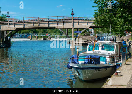 Motor boats moored on the River Thames outside the lock at Goring-on-Thames in the beautiful Thames Valley, Oxfordshire, England,UK, - Stock Photo