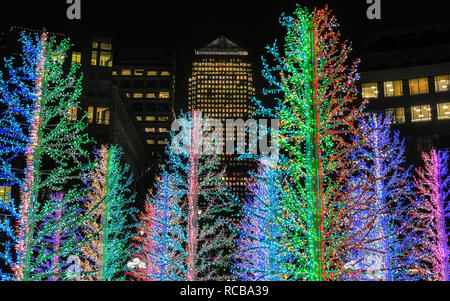 Canary Wharf, London, UK, 14th Jan 2019. The pretty 'Sasha Trees' installation at Westferry Circus. The colourful Canary Wharf Winter Lights installations once again open to public viewing and interactive fun in and around Canary Wharf from Jan 15th until Jan 26th. Credit: Imageplotter News and Sports/Alamy Live News - Stock Photo
