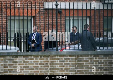 London, Theresa May said Monday she was against delaying Britain's exit from the European Union. 15th Jan, 2019. British Prime Minister Theresa May (2nd L) leaves 10 Downing Street to make a statement in the House of Commons, in London, Britain, on Jan. 14, 2019. Theresa May said Monday she was against delaying Britain's exit from the European Union, insisting the March 29 departure date was still her target. A delayed parliamentary vote on the Brexit deal will take place on Jan. 15, 2019. Credit: Tim Ireland/Xinhua/Alamy Live News - Stock Photo