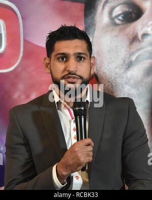 London, UK. 15th January, 2019. WBO Welterweight World Champion Terence 'Bud' Crawford and Amir 'King' Khan make a long-awaited announcement during Crawford-Khan Press Conference at The Landmark London Hotel on Tuesday, 15 January 2019. LONDON, ENGLAND. (Editorial use only, license required for commercial use. No use in betting, games or a single club/league/player publications.) Credit: Taka G Wu/Alamy Live News - Stock Photo