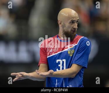 15 January 2019, Berlin: Handball: WM, Russia - Brazil, preliminary round, group A, 4th matchday. Russia's Timur Dibirov raises his arms and gets the red card a little later after a push against the Brazilian goalkeeper. Photo: Soeren Stache/dpa - Stock Photo