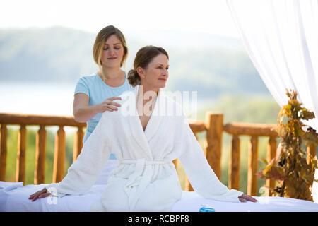 A woman receiving a massage - Stock Photo