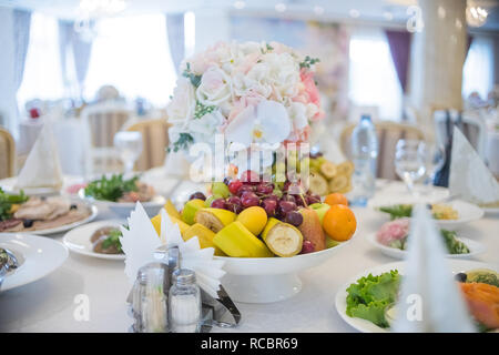 Festive table setting. Wedding decor. Table setting in fine art style. Table decor. Catering wedding ceremony, Birthday,wedding celebration at a restaurant. beautiful small bouquets on a table. selected focus - Stock Photo