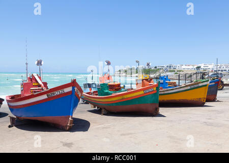 Colourful old wooden fishing boats on the slipway  in the fishing village of Arniston, Agulhas, Western Cape, South Africa, a popular tourist destinat - Stock Photo