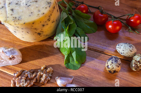 Rustic table with different elements to prepare salads with cheese. Natural food. - Stock Photo
