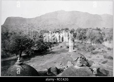 Pawagadh Hill. Archaeological Survey of India Collections: India. 1880s. Ruins and Pawagadh Hill from the north-west corner of the Jami Masjid, Champaner.  Image taken from Archaeological Survey of India Collections: India Office Series (volume 17: Gujarat).  Originally published/produced in 1880s. . Source: OIOC Photo 1000/17(1847),. Author: Cousens, Henry. - Stock Photo