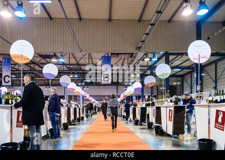 STRASBOURG, FRANCE - FEB 19, 2018: Customers tasting and buying French wine at the Vignerons independant English: Independent winemakers of France wine fair in Strasbourg - Stock Photo