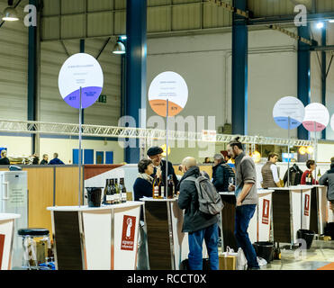 STRASBOURG, FRANCE - FEB 19, 2018: Happy Customers tasting and buying French wine at the Vignerons independant English: Independent winemakers of France wine fair in Strasbourg - Stock Photo