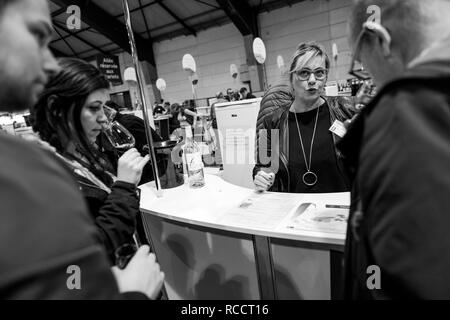 STRASBOURG, FRANCE - FEB 19, 2018: Friends tasting and buying French wine at the Vignerons independant English: Independent winemakers of France wine fair in Strasbourg - Stock Photo