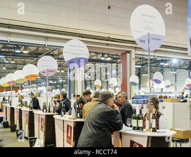 STRASBOURG, FRANCE - FEB 19, 2018: Rows of Customers tasting and buying French wine at the Vignerons independant English: Independent winemakers of France wine fair in Strasbourg - Stock Photo