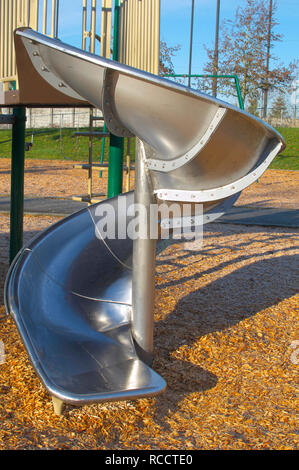 A metal spiral slide part of some playground apparatus from a children`s play area in a local park in Pitt Meadows, British Columbia, Canada. - Stock Photo