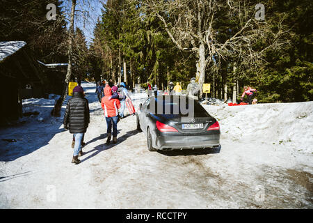 SEEBACH MUMMELSEE, FEB 25, 2018: Luxury Mercedes-Benz CLA45 AMG parked on a sledding slope in Black Forest, Germany  - Stock Photo