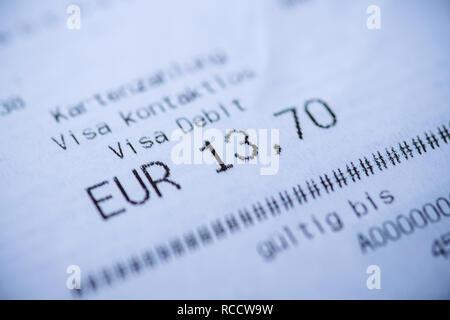 PARIS, FRANCE - JAN 6, 2018: Macro detail of Visa Debit receipt issued in Germany for 13,7 Euros - Stock Photo