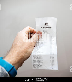 PARIS, FRANCE - FEB 21, 2018: Macro detail of Supermarket receipt issued in Germany by Edeka food supermarket  - Stock Photo