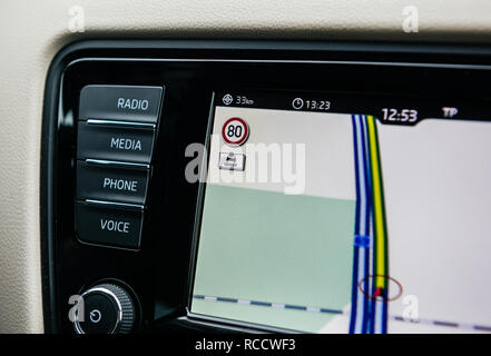 FRANKFURT, GERMANY - FEB 2, 2018: Car GPS infotainment display system showing lanes speed limit to 80KMH and wet road sign of a German autobahn on the digital map - Stock Photo