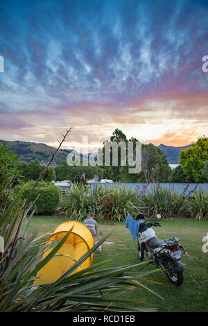 Akaroa, Canterbury, New Zealand - January 5 2019: Relaxing and enjoying the sunset at the Akaroa Top Ten Holiday Park - Stock Photo