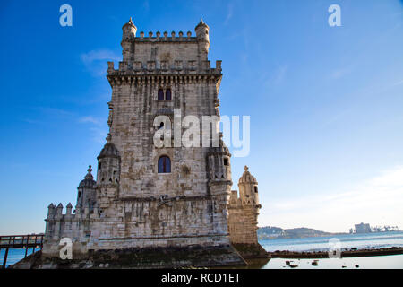 Lisbon, Belem Tower at sunset on the bank of the Tagus River - Stock Photo