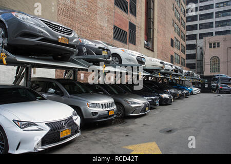 SP+ Parking, stacked parking garage, 355-363 W 34th St, New York, NY 10001, USA. A multi-level stacked parking lot car park in America. - Stock Photo