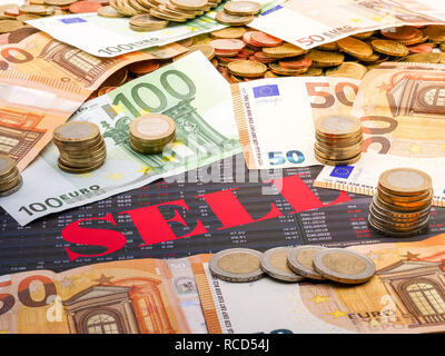 Image of money and the word sell on investment paper - Stock Photo