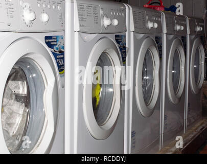 Washing household machines stand in a row and wash the linen of the population. Russia. - Stock Photo