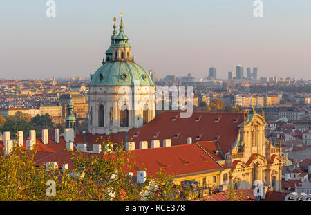 Prague - The Town with the St. Nicholas church in evening light. - Stock Photo