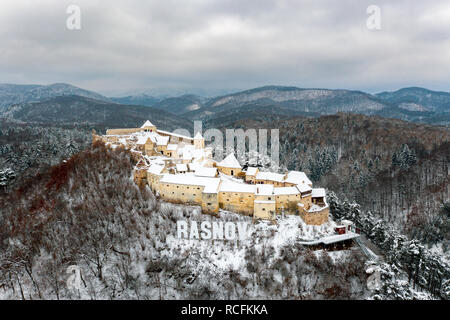Rasnov Fortress in Transylvania covered in snow after a heavy snowfall