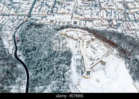 Rasnov Fortress and Rasnov City in winter time covered in snow