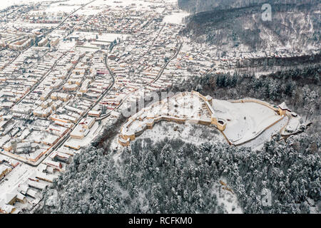 Rasnov City and Fortress covered in snow in mid winter season