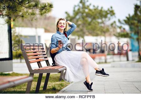 Caucasian Blonde Woman Kissing A Black Man On Forehead