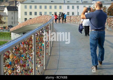Makartsteg bridge, Salzburg, Austria. The bridge is a popular site for placing love padlocks - Stock Photo