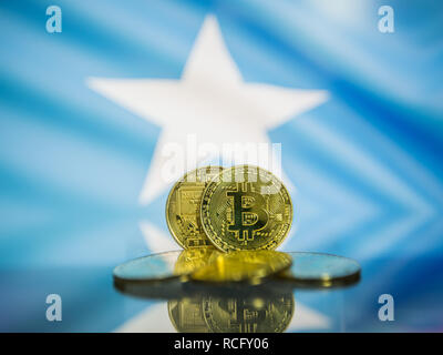 Bitcoin gold coin and defocused flag of Somalia background. Virtual cryptocurrency concept. - Stock Photo