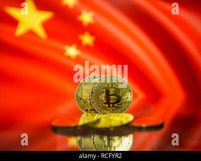 Bitcoin gold coin and defocused flag of China background. Virtual cryptocurrency concept. - Stock Photo