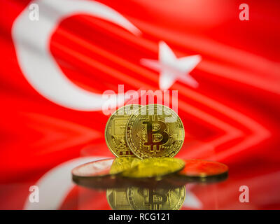 Bitcoin gold coin and defocused flag of Turkey background. Virtual cryptocurrency concept. - Stock Photo