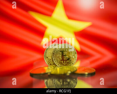 Bitcoin gold coin and defocused flag of Vietnam background. Virtual cryptocurrency concept. - Stock Photo