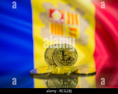 Bitcoin gold coin and defocused flag of Andorra background. Virtual cryptocurrency concept. - Stock Photo