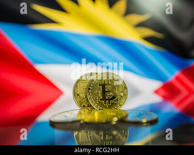 Bitcoin gold coin and defocused flag of Antigua and Barbuda background. - Stock Photo