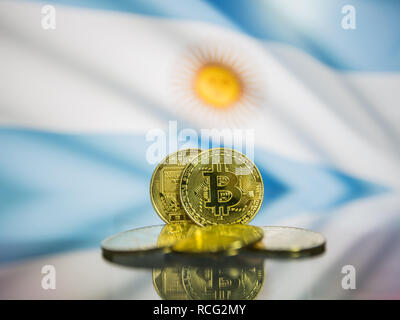 Bitcoin gold coin and defocused flag of Argentina background. Virtual cryptocurrency concept. - Stock Photo