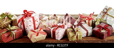 Panorama banner with Christmas gifts in colorful gift-wrapped boxes tied with bows - Stock Photo