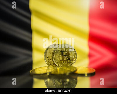 Bitcoin gold coin and defocused flag of Belgium background. Virtual cryptocurrency concept. - Stock Photo
