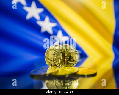 Bitcoin gold coin and defocused flag of Bosnia and Herzegovina background. - Stock Photo