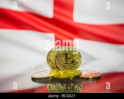 Bitcoin gold coin and defocused flag of England background. Virtual cryptocurrency concept. - Stock Photo