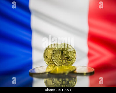 Bitcoin gold coin and defocused flag of France background. Virtual cryptocurrency concept. - Stock Photo