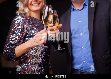Picture of happy couple with champagne glasses in studio - Stock Photo
