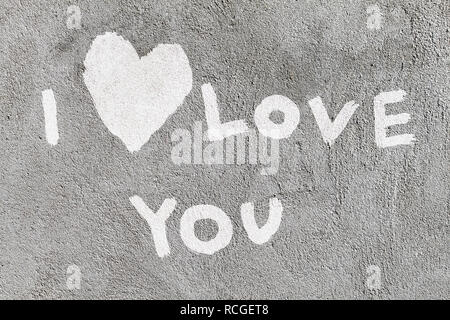 inscription I love you with abstract heart on the concrete wall - Stock Photo
