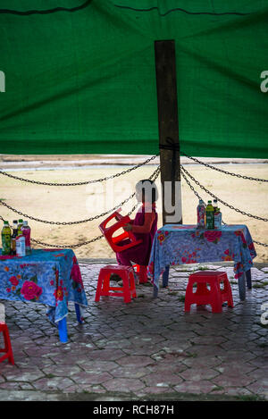 Little girl at Colourful Bac Ha Sunday Market in the Flower Hmong minority village in Northern Vietnam - Stock Photo