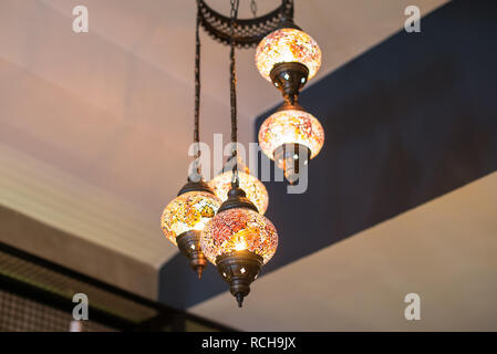 Antique old retro vintage chandelier lamps. This old retro chandeliers are glowing. Interior antique lighting design - Stock Photo
