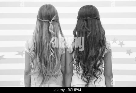 Girls children long curly hair rear view. Treat hair proper way according type. Apply conditioner mask after washing and spray oil before styling curls. Hairstylist tips. Easy hairstyles every day. - Stock Photo