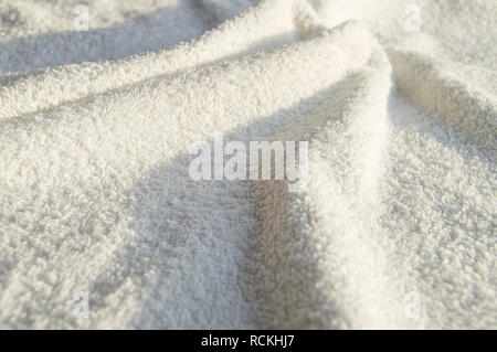 White Terry soft towel for SPA treatments, texture, background. - Stock Photo