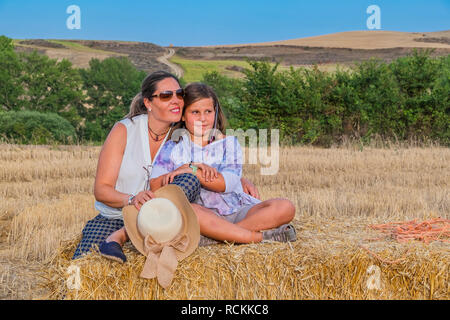 mother and daughter enjoying themselves in the countryside - Stock Photo