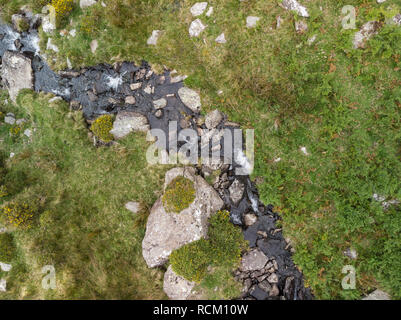 Drone aerial view landscape of river flowing over rocks and down waterfall in Snowdonia - Stock Photo